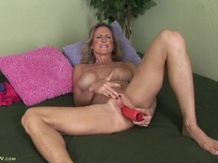 Freckled mature babe moans as she fucks her toy videos