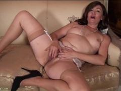 Gorgeous mature chick in tan stockings masturbates solo videos
