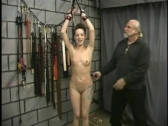 Flogging a slim cutie in his dungeon clip