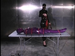 Head to toe purple latex on this bondage sub movies at find-best-lingerie.com