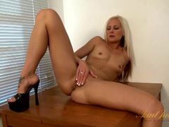 Naked babe in black platform heels fucks a toy videos