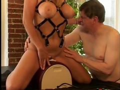 Kinky wife rides a sybian as her man watches videos
