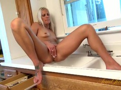 Blonde on the kitchen counter plays with her cunt movies at kilogirls.com