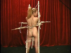 Asian girl in intricate and elegant rope bondage tubes at asian.sgirls.net