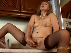 Granny in stockings makes her pussy happy videos