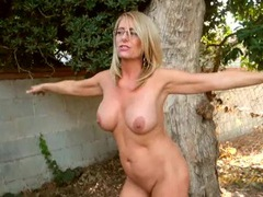 Busty milf chatting it up in the backyard movies at sgirls.net