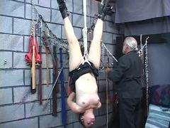 Rope bound cutie hangs upside down in his dungeon videos