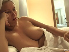 Freshly showered chick with her tits out in a hotel room videos