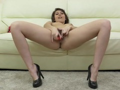 Naked chick in heels plays with her big bush tubes