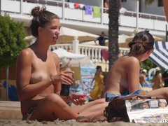 Friends with perky tits relaxing on the beach videos
