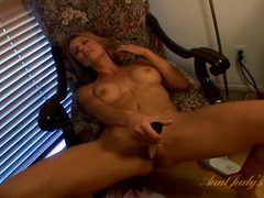Milf hottie with a stunning pink cunt fucks her toy movies