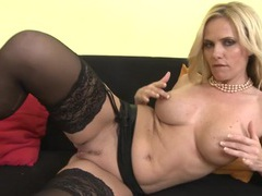 Hot milf babe in black stockings rubs her cunt videos