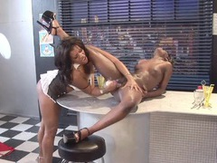 Ebony lesbians have hot sex on the diner counter tubes