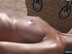 Girls tanning their naked tits on the beach tubes