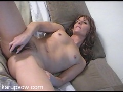 Leggy lady slides a silver toy into her cunt tubes
