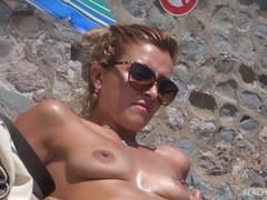 Tiny boobs cutie relaxes on a beach tubes