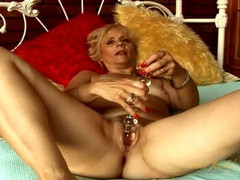 One toy in her mature cunt and another for her clit videos