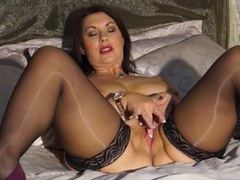 Shiny stockings on a sexy mature chick in lipstick videos