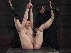 Masters slowly put the girl in rope bondage tubes