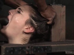 Wooden bondage device on this kinky slave girl videos