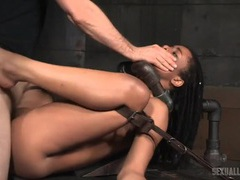 Metal bondage device holds the slut for hard fucking videos