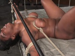 Black whore tied to the bed and fucked in the dungeon videos