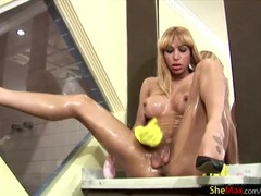 Big tranny dick looks hot covered in slippery oil movies at sgirls.net