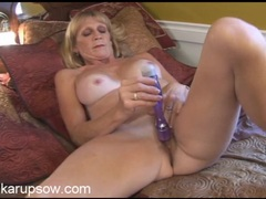 Mature cunt in close up as she plays with a toy videos