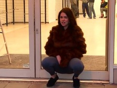 Public cameltoe and pissing show from a girl in fur tubes