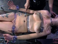 Teen tightly strapped down to a table videos