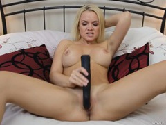 Big dildo does good things for the hot blonde babe movies at lingerie-mania.com