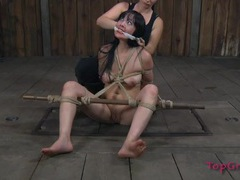 Kinky cutie bound by rope as mistress plays videos