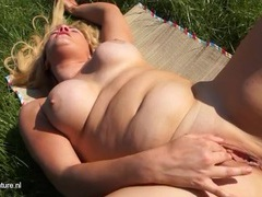 Solo mom in the grass rubbing her wet cunt videos