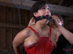 Painfully tight latex corset on the curvy submissive movies at find-best-hardcore.com