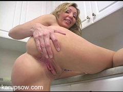 Naked housewife with great tits hangs out in her kitchen movies at sgirls.net