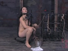 Slave in cast iron bondage practices her knots videos