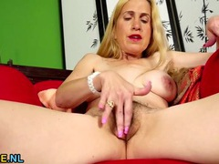 Mommy plays with her hairy snatch movies at lingerie-mania.com