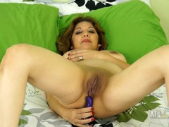 Tight shaved mature pussy gets wet from a vibrator videos