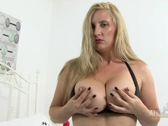 Animal print stockings on this big tits blonde milf videos
