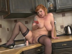 Thick redheaded mom fucks a big dildo slowly videos