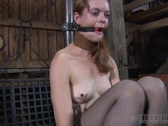 Drooling around her ball gag during a torture scene videos