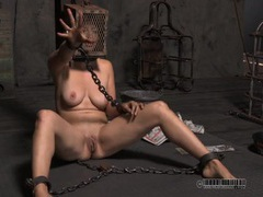 Chained girl with her head in a metal cage videos