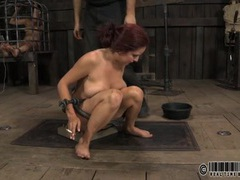 Slutty redhead smokes in cast iron bondage videos