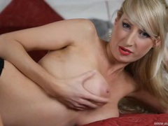 Big breasted babe in red lipstick strips in bed movies at sgirls.net