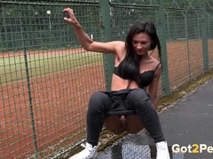 Hottie in a black bra pisses in public videos