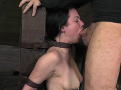 Cute slut in a leather collar takes a throat fucking tubes