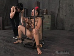 Two cuties submit to metal bondage in a dungeon movies at sgirls.net