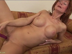 Mature hottie with great fake boobs fucks a toy videos