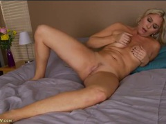 Classy and curvy milf arouses her cunt in bed tubes