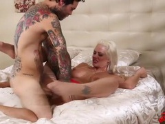 Tattooed couple enjoys a hot hardcore fuck videos